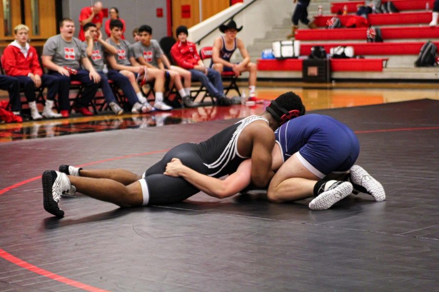 13 Redhawks advanced to the 5A Region II tournament at Independence High School after placing in the top four of their respective weight classes at the District 8-5A tournament Friday and Saturday The Colony High School.