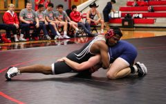 Wrestling revs up for three more days of competition