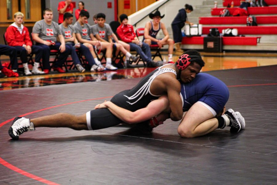 In their first duel against Northwest High School, senior Gervante Thompson looks to gain control of his opponent. In their upcoming duel and tournaments this weekend, the team is looking to hold their record on the girls side, and push for higher ranking with the boys.