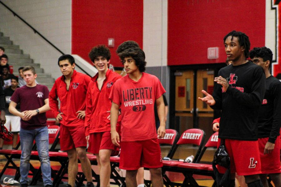 Redhawk wrestlers cheer on their teammates from the sideline during a match. The boys' and girls' teams take on Heritage and Whitesboro on Thursday and compete in the Coyote Classic on Saturday.
