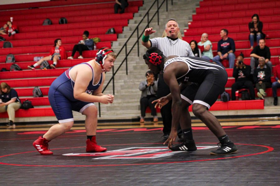 Squaring up with his opponent, junior Prince Ugoh looks to take a shot. With a first place medal from districts and regionals, Ugoh has high hopes for the upcoming competition at the state meet Thursday at the berry Center in Cyprus Tx.
