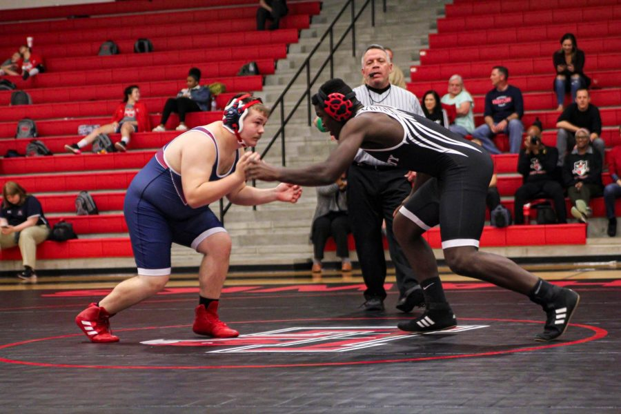 As a second year wrestler, junior Price Ugoh begins his match in the 220 lb weight class. In his first year of wrestling, Ugoh had an undefeated season, and is now looking to sustain his record this season.