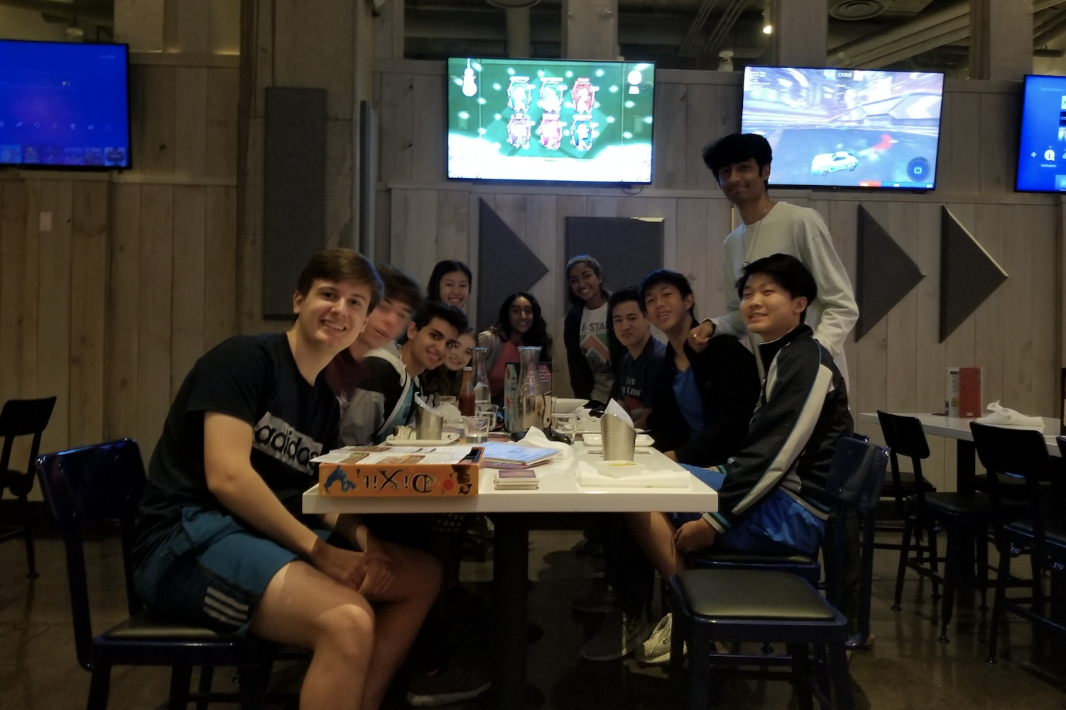 Orchestra seniors smile during their first social of the school year at Nerdvana Frisco on Nov. 9. With 21 seniors this year, the socials are a tradition of the program.