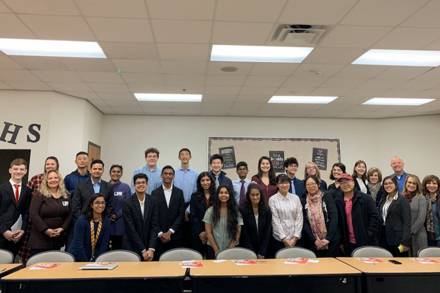 GT American Studies students pose with  their teachers Swapna Garnder and Emily Griffin, along with guests, after completing their Saving the System presentations. The project came to an end on Monday after month's of work.