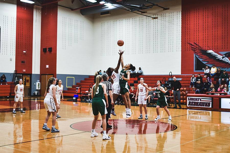 Competing in the Frisco ISD Tip Off Tournament on Nov. 14, the girls' team aims to get possession of the ball at the beginning of the period.The boys' team is searching for it's first district win Tuesday night, and the girl's team looks for their fifth win.