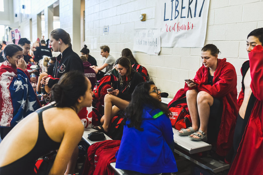 Redhawks sit in their designated section alongside schools from across the area at Bruce Eubanks Natatorium Friday and Saturday