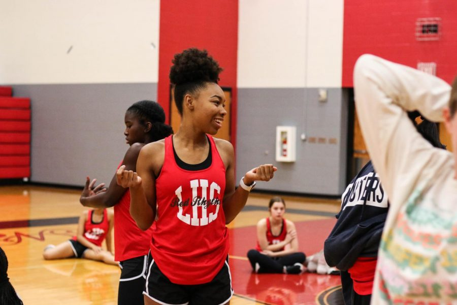 """Presenting their competition routines and dances, Red Rhythm performed in a district wide drill team showcase on Tuesday. """"Unlike football season, where we get to perform the same routine every week, for contest, we only have two days of contest to actually perform and compete,"""
