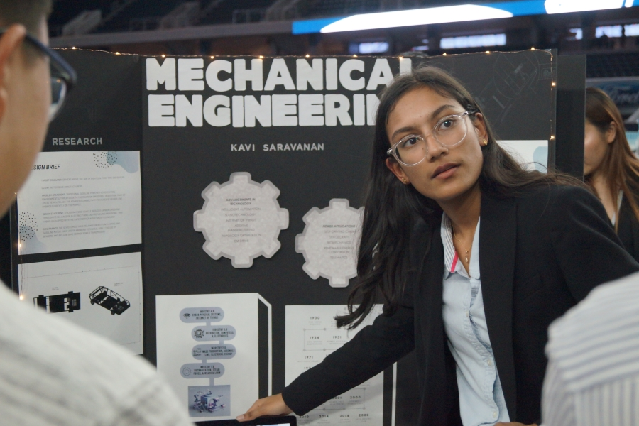 Senior Kavi Saravanan points to her board while presenting her ISM board. Saravanan did her project over mechanical engineering.