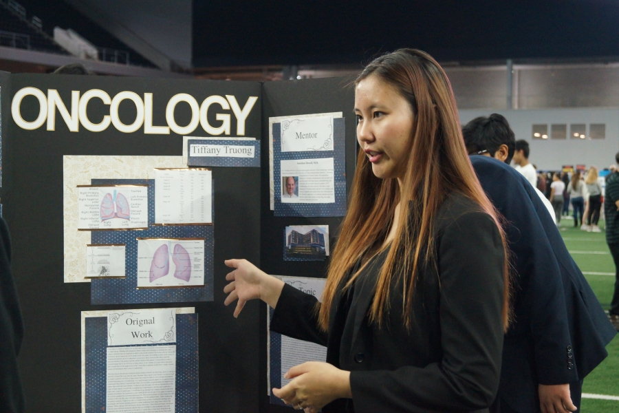 Pointing to a diagram of lungs, senior Tiffany Truong studied oncology for ISM.