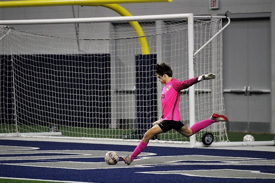 Goalie, ____ kicks the ball far out into the field. The Redhawks played against Reedy High School on Jan 17. 2020.