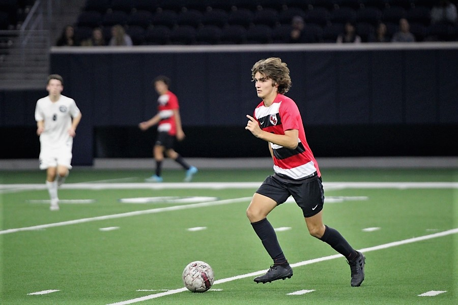 Sophomore Braden Wright runs with the ball to pass onto his teammates. The Redhawks play against Lone Star Rangers with the boys at starting at 7 p.m. at Lone Star and the girls kicking off at 7:15 p.m.