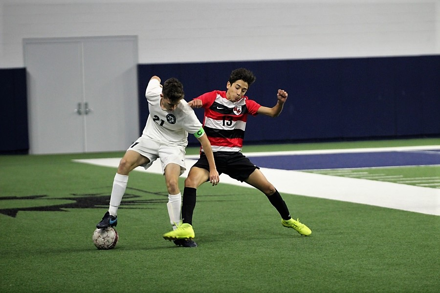 Junior Joquin Padron attempts to take the ball away from his opponent during a game. The boys' side plays at Liberty at 7:15 p.m., while the girl's side starts at Frisco at 7:00 p.m.