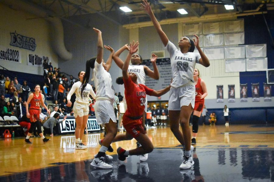Surrounded by Lone Star Rangers, Jazzy Owens-Barnett reaches for her balance.