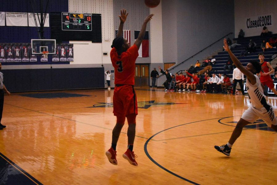 Senior Terry Moss jumps up for a shot at the three point line. Redhawks take on the Reedy Lions Friday at the nest.