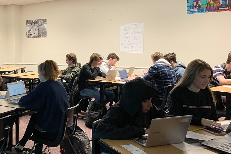 "English 4 students work on their Othello essays in English teacher Shannon Glidwell's room on Thursday. ""The students will be expected to connect the themes and elements of the play to the universal themes shown in the real world,"" Glidwell said."