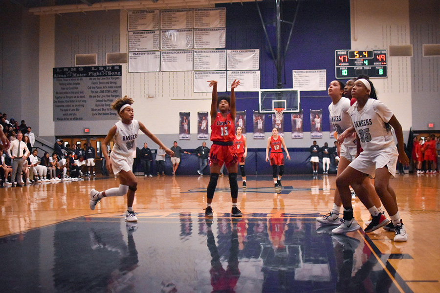 Shooting a freethrow in an earlier game against Lone Star, junior Zoe Junior and the rest of the girls' basketball team seek to continue its undefeated district season Tuesday night.  Facing the Raccoons at Frisco the girls play at 6 p.m. and the boys' side team starts at 7:15 p.m.