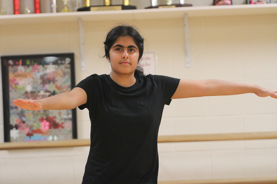Setting up a pirouette, junior Diya Nariani is learning new choreography for her 4A Dance III class.