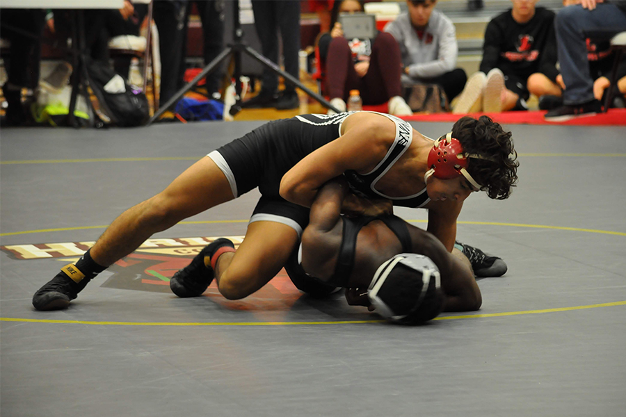 Working a bar arm, senior Armando Vasquez looks to maintain control of his opponent. In their dual tonight, wrestling boys hope to recover a loss to Heritage last week, and the girls aim to continue their win streak Thursday at Reedy High School against Reedy and Centennial at 6:00 p.m.