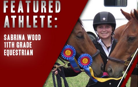 Junior Sabrina Wood poses with her horses and awards following a riding competition. As horseback riding is not offered in the district, Wood balances her sport on top of advanced classes.