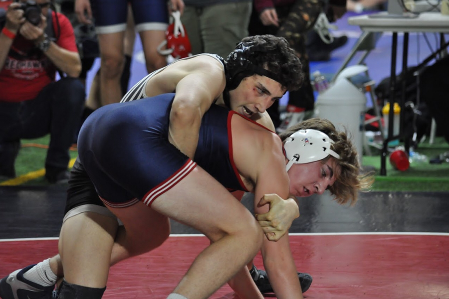 Double win for wrestling, taking down the Knights and Cougars