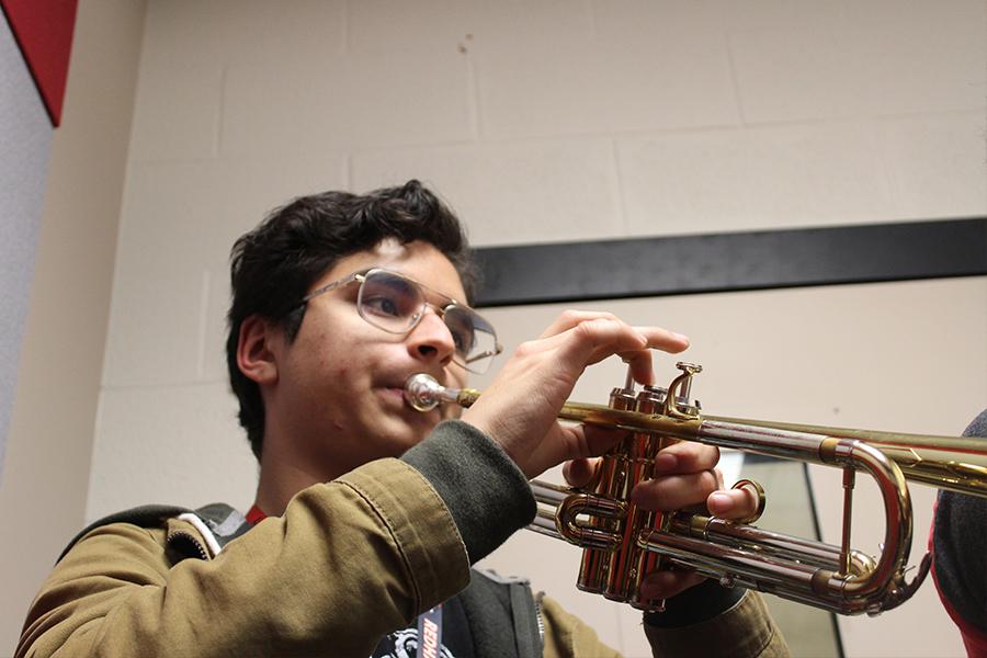 Playing a solo, freshman Ezekiel Rubio plays trumpet.