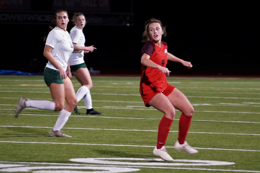 Ally White, junior, looks at her teammates run with the ball. The girls' side will play at Liberty at 7 p.m. and the boys' side plays at Lone Star at 7:15 p.m.