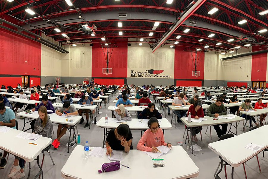 Students fill the gym for a AP World History exam in April 2019. Students in second semester AP courses have until Feb. 21 at 4:30 p.m. to register.