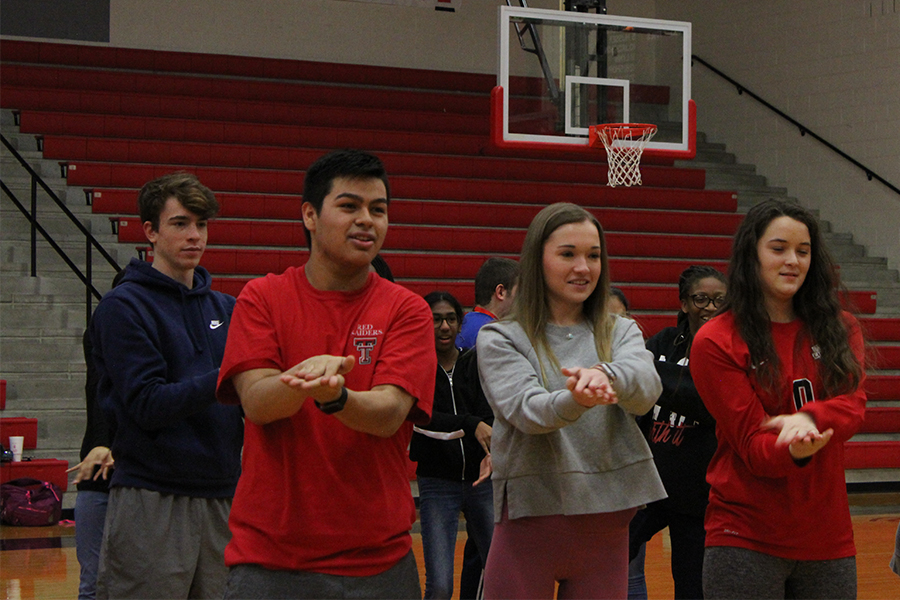 Seniors Emma Lindley and Andres Venegas lead the way for Just Dance on Friday, Jan. 31, 2020.