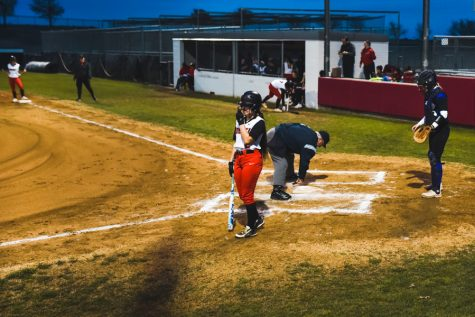 Stepping up to bat, baseball and softball in action Tuesday