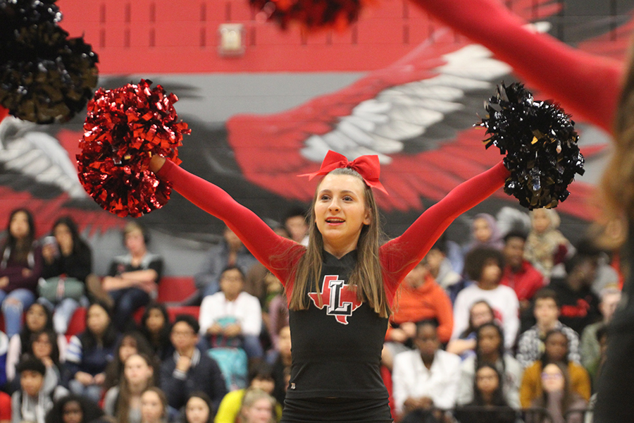 With her poms held high, sophomore Alyssa Murphy looks onto the upperclassmen at the spring pep rally on Tuesday, Feb. 11, 2020.