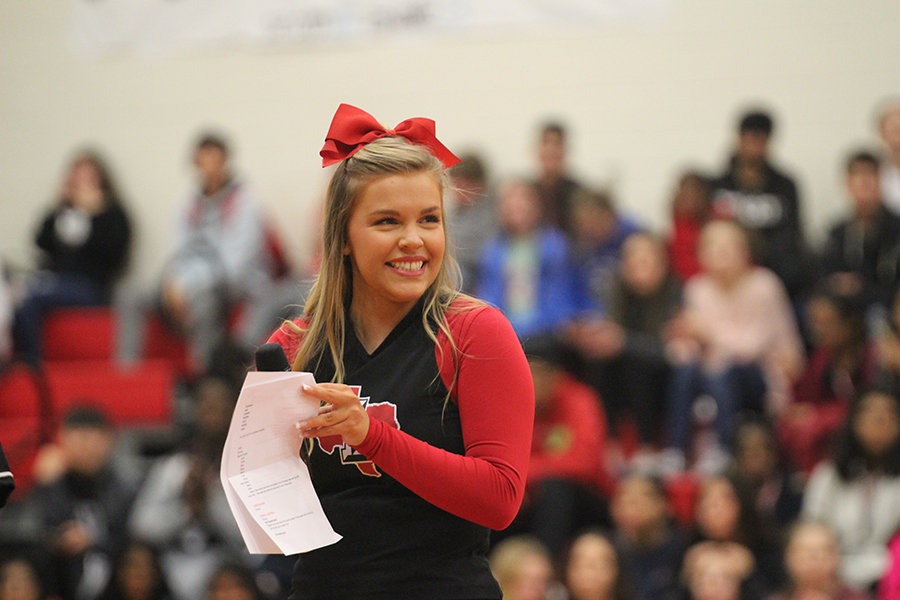 Student Council Vice President and senior Rileigh Horcher takes the microphone and helps lead the pep rally on Tuesday, Feb. 11, 2020.