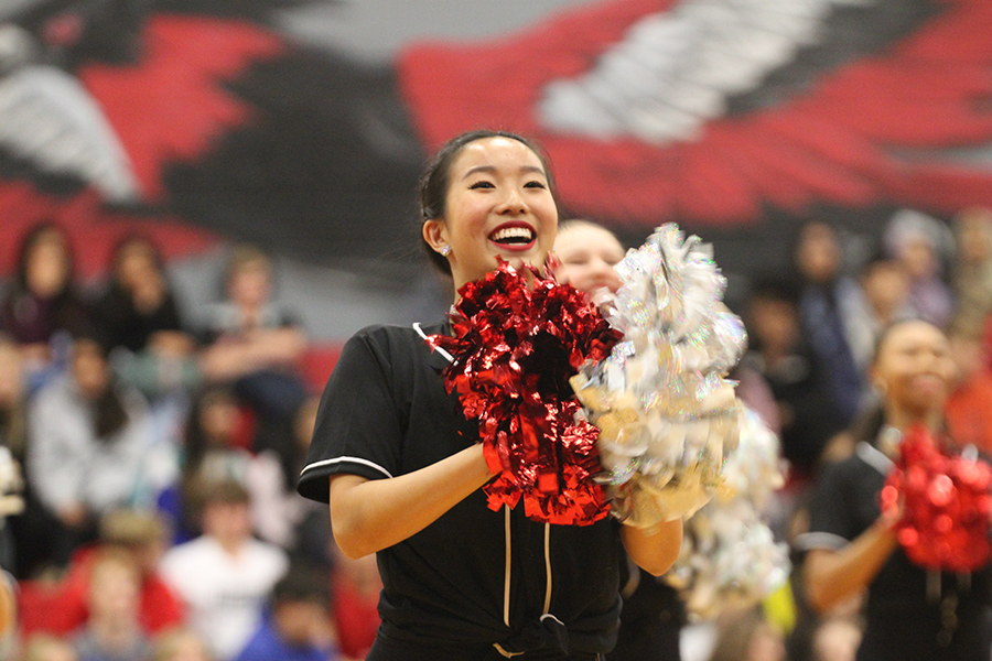 Red Rhythm junior lieutenant Annie Tian performs at the spring pep rally. With COVID-19, Red Rhythm, cheer, and color guard have to postpone their tryouts.