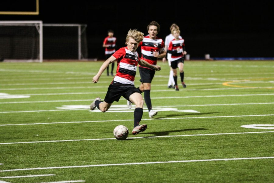 Winding+up+a+kick%2C+sophomore+Jack+Bryan+prepares+to+take+a+shot+at+the+goal.+Taking+two+wins+Tuesday+against+the+Heritage+Coyotes%2C+soccer+continues+to+work+in+practice+for+their+next+competition.+