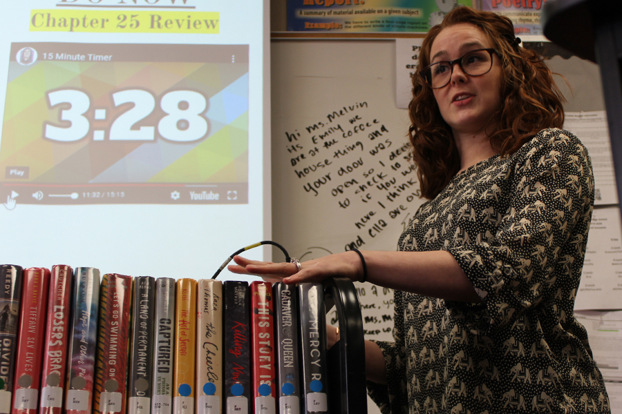 Chelsea Hamilton, librarian, talks to English teacher, Vanessa Melvin's English class about books.