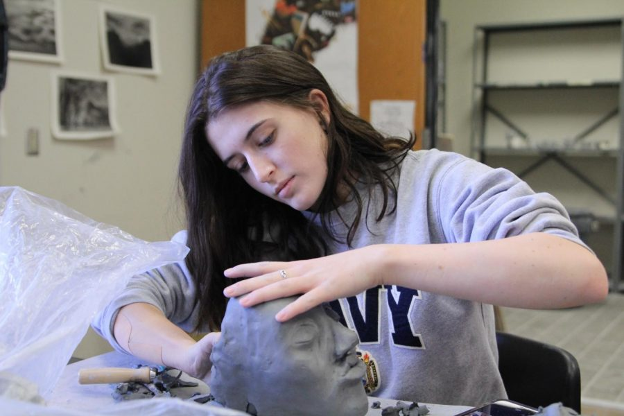 Senior Megan Weidenbach is an artist and wrestler on campus. She plans to further her education at the University of Oklahoma.