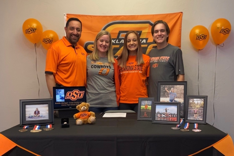 Dad CJ, mom Courtney, senior Amelia, and brother Andrew Jauregui pose for a picture in their home as they set up a signing day for Amelia despite unfortunate circumstances surrounding COVID-19.