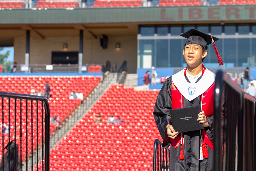 Redhawk alumni Jonathan Peng makes his way across the graduation stage on May 31, 202 while wearing his National Honor Society stole. Stoles, along with honors cords and other academic awards, are available in front of the auditorium for class of 2021 graduates on Tuesday and Wednesday.