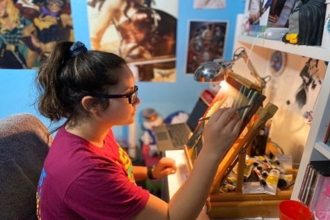 Junior Emma Valera works on a piece for her art portfolio. AP Art students bring the creativity to their bedrooms to finish up their portfolios for the year.