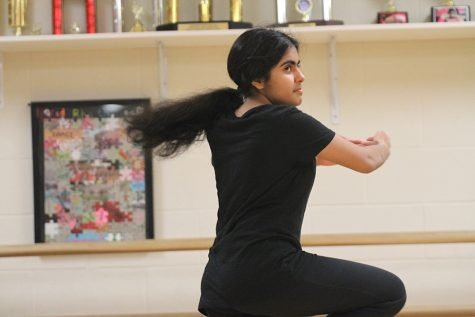 Junior Diya Nariani practices her own choreography. Throughout the year Dance I has had several mini choreography projects, but to finish off the year, they have 8 weeks to prepare one final routine.