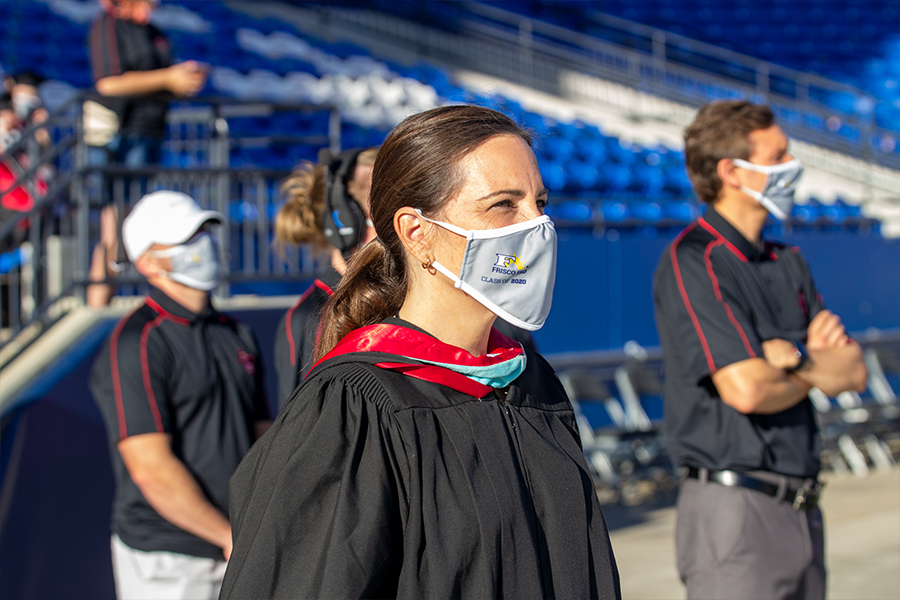 Wearing her Frisco ISD class of 2020 graduation masks provided by Jostens, principal Ashley Rainwater stands on the field at Toyota Stadium for graduation on Saturday, May 30, 2020.
