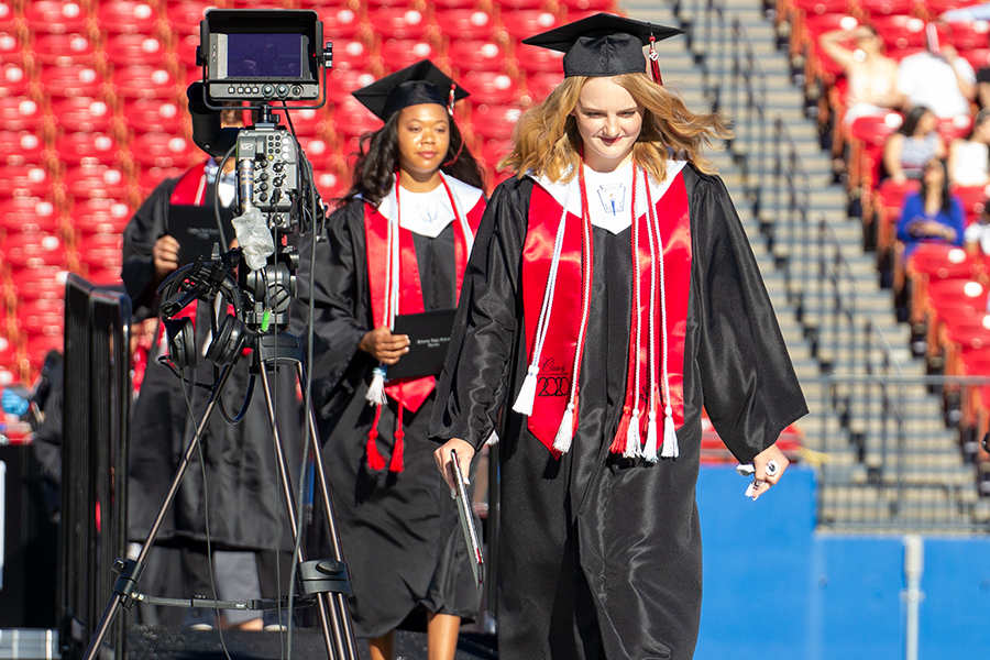 With her diploma in hand, graduate Kasey Harvey makes her way across the stage at Toyota Stadium for the class of 2020 graduation on Saturday, May 30, 2020.