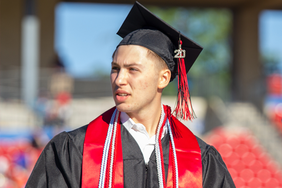 Looking towards the rest of the class of 2020, senior Roy Nitzan makes his way off the stage at Toyota Stadium for the class of 2020 graduation on Saturday, May 30, 2020.