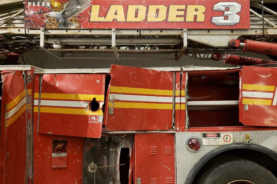 Parked on West Street near Vesey Street on September 11, 2001, the FDNY Ladder 3 truck was damaged as a result of the collapse of the Twin Towers. The truck is now on display at the 9/11 Memorial & Museum in New York City.