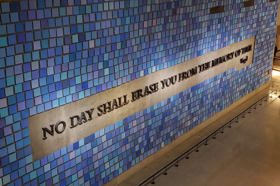 "Occupying a huge wall in the 9//11 Memorial & Museum, this mural created by Spencer Finch is titled ""Trying to Remember the Color of the Sky on That September Morning"". Comprised of 2,983 watercolor squares, it features a quote from Roman poet Virgil that reads ""No day shall erase you from the memory of time""."