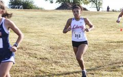 Junior Jada Williams runs in a cross country meet last school year. Williams and her fellow Redhawks runners participated in their second meet of the year Saturday at Warren Park, bringing home a 7th place finish for the boys and a 21st place finish for the girls.