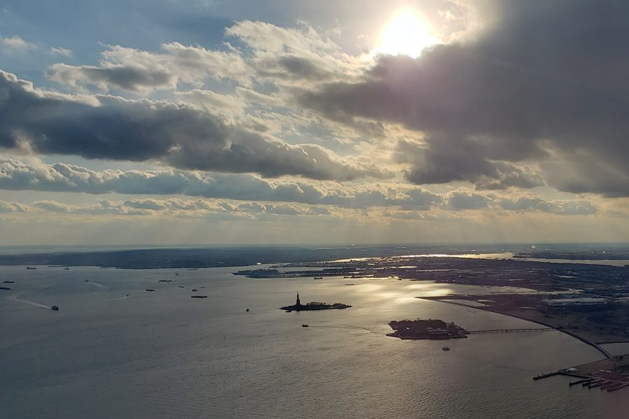 Locating to the southwest from the top of the One World Trade Center, visitors can see the Statue of Liberty, approximately two miles away in the Upper New York Bay.