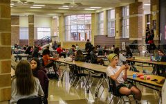 "Students eat their lunches while social distancing in the cafeteria. With more students returning to campus after having the opportunity to switch learning environments. ""When looking at the impact [of more students returning to campus], we have to look at the safety and security of our campus in general,"" principal Ashley Rainwater said. ""We're going to look at numbers in our lunchroom, look at numbers in bathrooms, look at our numbers in our hallways to make sure we're able to socially distance while we're at school."""