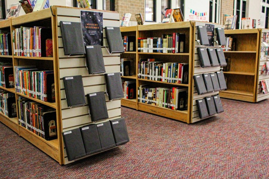 In order to spread the Halloween spirit, the library has covered the names of popular mystery books.