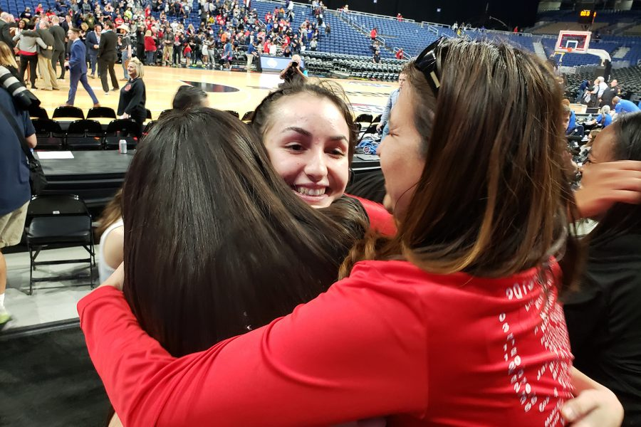 Senior Maya Jain hugs friends and family after UIL State Championship tournament. After the Redhawks head home, they will have to adapt to a new normal.
