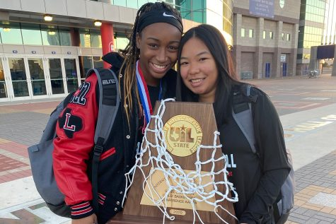 Holding the UIL 5A state championship trophy, MVP of the tournament Jazzy Owens-Barnett  and Kayla Pernis (left) stand outside the Alamodome after the Redhawks claimed the first basketball state title in Frisco ISD history. But the team didn